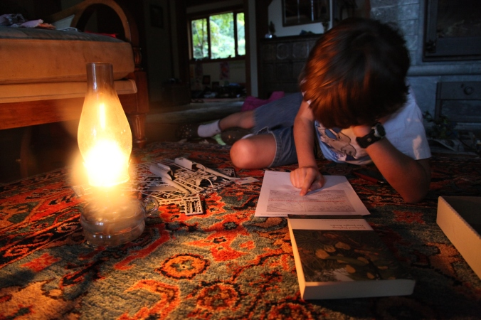 Reading by Hurricane Lamp