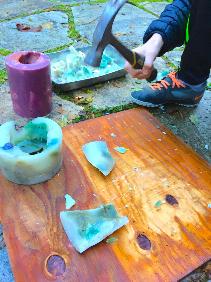 Hammering Out Wax Chunks From Used Candles © Liesl Clark