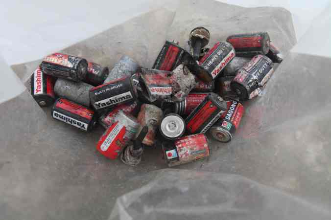 Batteries found in just a few minutes of searching amidst the town dumping site just outside the walls of the royal city of Lo Manthang. © Liesl Clark